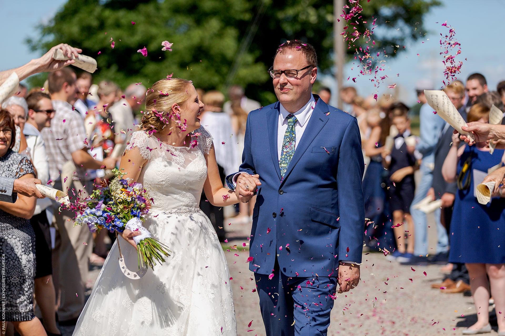 long focal length lens 115 mm wedding couple flower petals