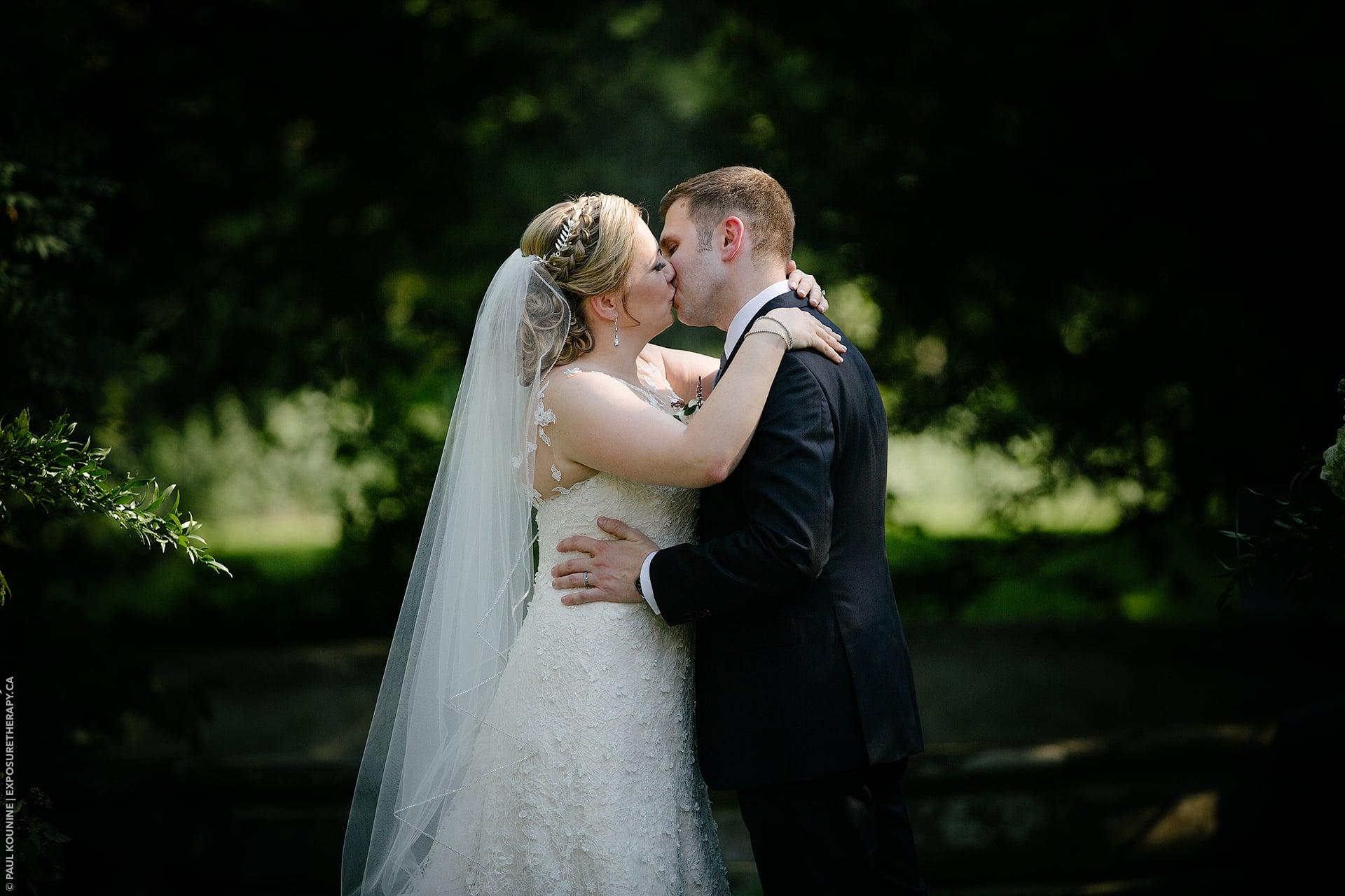 200 mm lens on full frame camera wedding couple kissing.