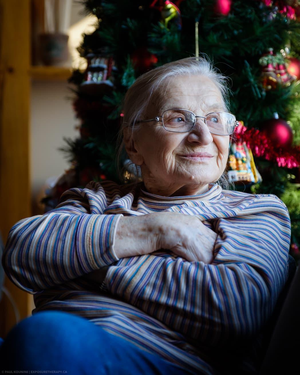 Available light portrait of elderly lady cool white balance