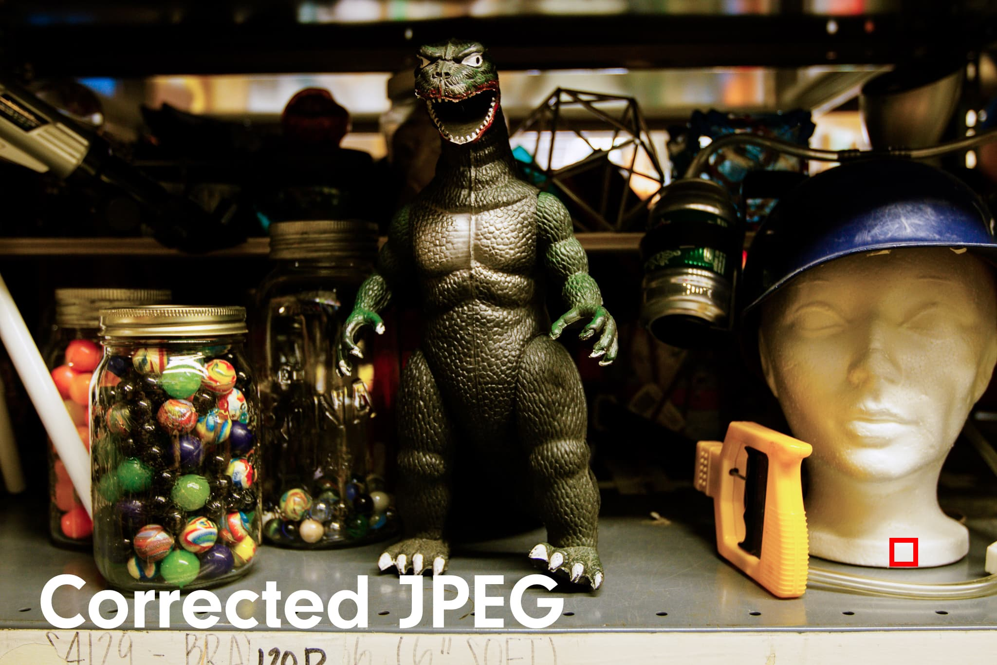 Godzilla toy in craft shop showing JPEG file whose white balance was corrected.